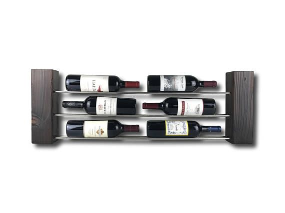 This modern/minimalist wine rack can be mounted on the wall or sit on the counter or floor. The cedar wood is set on fire and charred according to the traditional Japanese woodworking technique of Shou Sugi Ban. The burning exposes unique colors in the wood and unexpected texture.