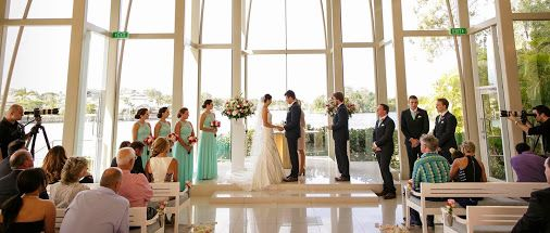 Kassi & Josh's wedding ceremony at the glass chapel at the Intercontinental Sanctuary Cove Resort.  Photo by White Pearl Photography.