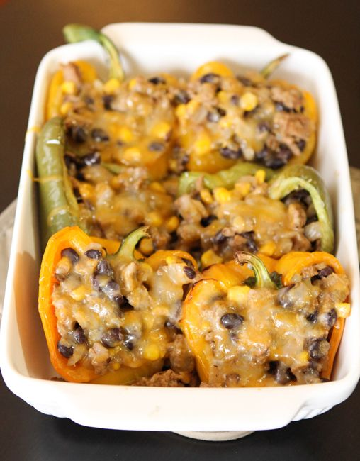 Corn and Black Bean Stuffed Peppers. Ingredients: 1/2 pound ground turkey, 1/2 large onion, 1 cup black beans, 1 cup frozen corn, 1 tbsp. taco seasoning, 3 large bell peppers, 1 cup of shredded cheese