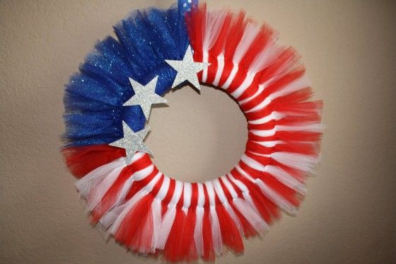 4th of July Tulle Wreath./ Canada Day Tulle Wreath. You could change this to Canada Day theme by doing red on each side with white top and bottom, and dangling a sparkly red maple leaf in the center.
