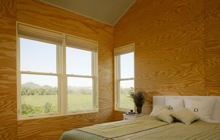 The plywood in the bedrooms updates the traditional expectation of a simple cabin interior