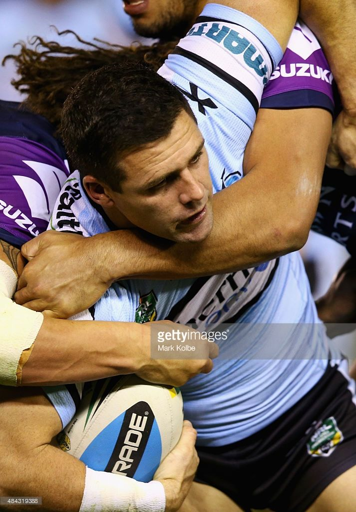 Michael Gordon of the Sharks is tackled during the round 23 NRL match between the Cronulla Sharks and the Melbourne Storm at Remondis Stadium on August 17, 2015 in Sydney, Australia.