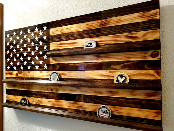 Rustic Wooden Challenge Coin Display, 13 3/4 tall X 24 Long. Will display  approximately 33 regular coins. Made from pine lumber and individual boards. Perfect size to see when entering a room without being overwhelming! We can do several stayles to include Military, Law Enforcement, Fire, Medical most are all the espresso muted color. All lettering, stars and symbols are of high quality vinyl. Message me for other requests and details! #rusticwoodenflag #Bluelineflag,