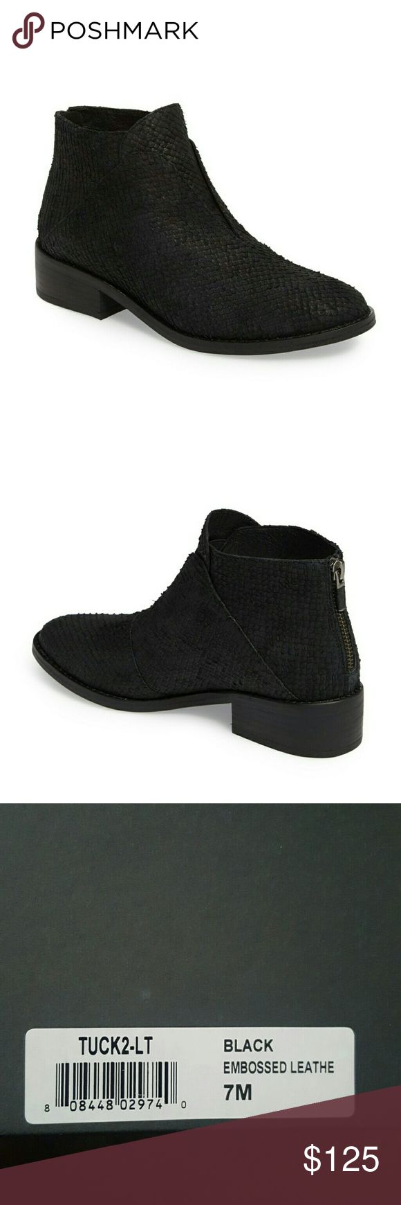 """Eileen Fisher Black Tuck Embossed Leather Size 7 M Brand new with Box. Nevet worn but the bottom of the shoes has a marking from the sticker. tag.   """" Laser-textured leather and a boldly notched vamp define this distinctive bootie outfitted with a convenient back zipper and a modest block heel. - 1 1/4"""" heel - 3 1/2"""" shaft - Back zip closure - Padded footbed - Leather upper, lining and sole - Imported"""" Eileen Fisher Shoes Ankle Boots & Booties"""