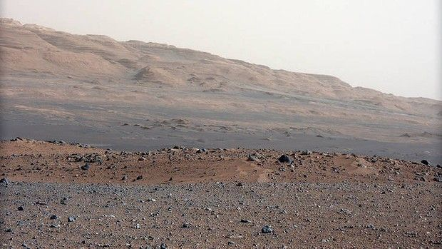 Portrait of Mars ... this image released by NASA on Monday, 27 August 2012, taken by the Mast Camera, highlights the geology of Mount Sharp, a mountain inside Gale Crater, where the Curiosity rover landed.