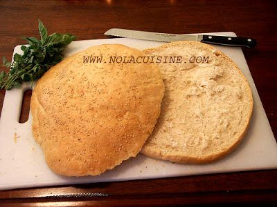 Muffuletta Bread Recipe | Nola Cuisine  Along with links to the olive salad that goes with it