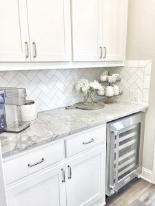 Kitchen Option: white shaker cabinets, gray/marble quartz counter tops, Grecian white marble subway tile in a herringbone