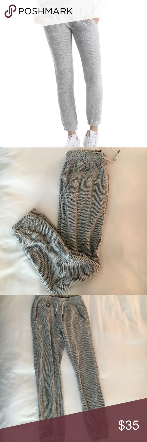 Publish Brand Cassidy Jogger Pant Size 27 Publish Brand Cassidy Jogger Pants Size 27. Grey/White Fabric with elastic waist and pant bottoms. Some pilling/loose string due to washing and nature of the fabric. Only worn a few times, comfy cute pants! Publish Pants Track Pants & Joggers