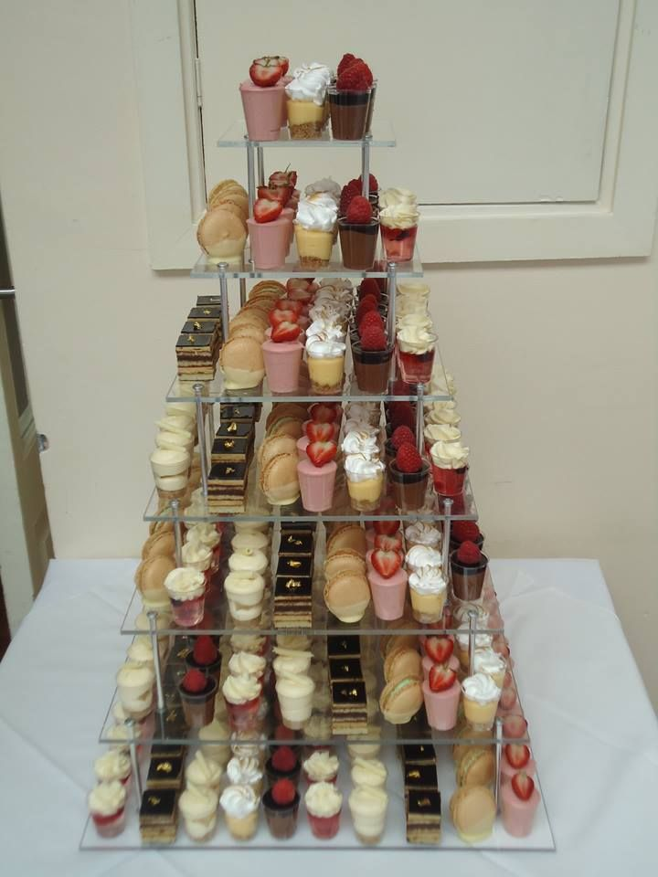 """Remember this tower of cakes we made? We just received this lovely testimonial:  """"Dear Xavier and Bee  Apologies with the delay in mailing our thanks but """"thank you"""" for a fantastic display of desserts for our wedding which matched perfectly our brief. Absolutely amazing!  Kind regards  Diane and Steve Bruce The Queen's Hotel""""  #cake #cupcake #dessert #strawberry #macaroon #lemon #chocolate #tower #mini #tiramisu #mousse #cheesecake"""