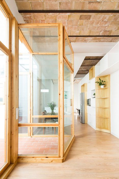 Cavaa Arquitectes has stripped back the interior of an apartment in Barcelona's Poblenou neighbourhood, creating an open-plan living space featuring traditional vaulted ceilings.