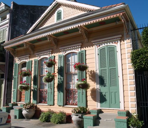 #Shotgun_houses are found throughout New Orleans.  Bold color combinations, columns, and #Victorian_gingerbread or lacy brackets are telltale signs of the New Orleans shotgun house.