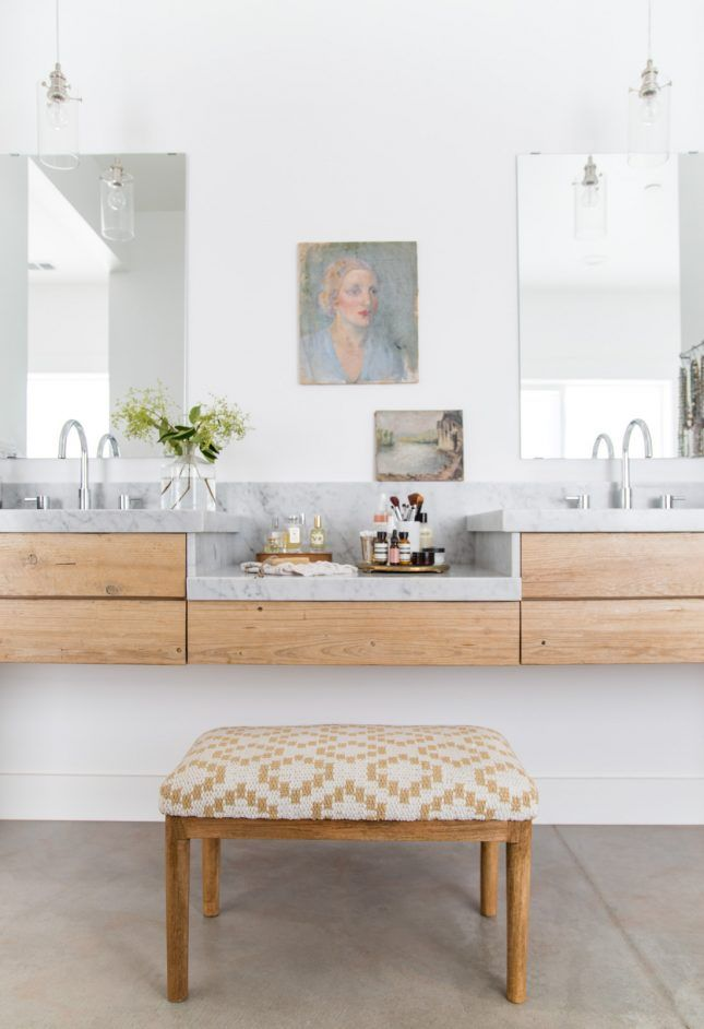 Give your bathroom even more of a cool factor with a dedicated vanity. All you need is a stool and a mini table to make your bathroom feel extra luxe and give your morning makeup routine its own special space.