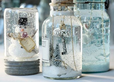never to soon to be thinking about christmas decor. homemade snow globes in old mason jars and corked bottles.