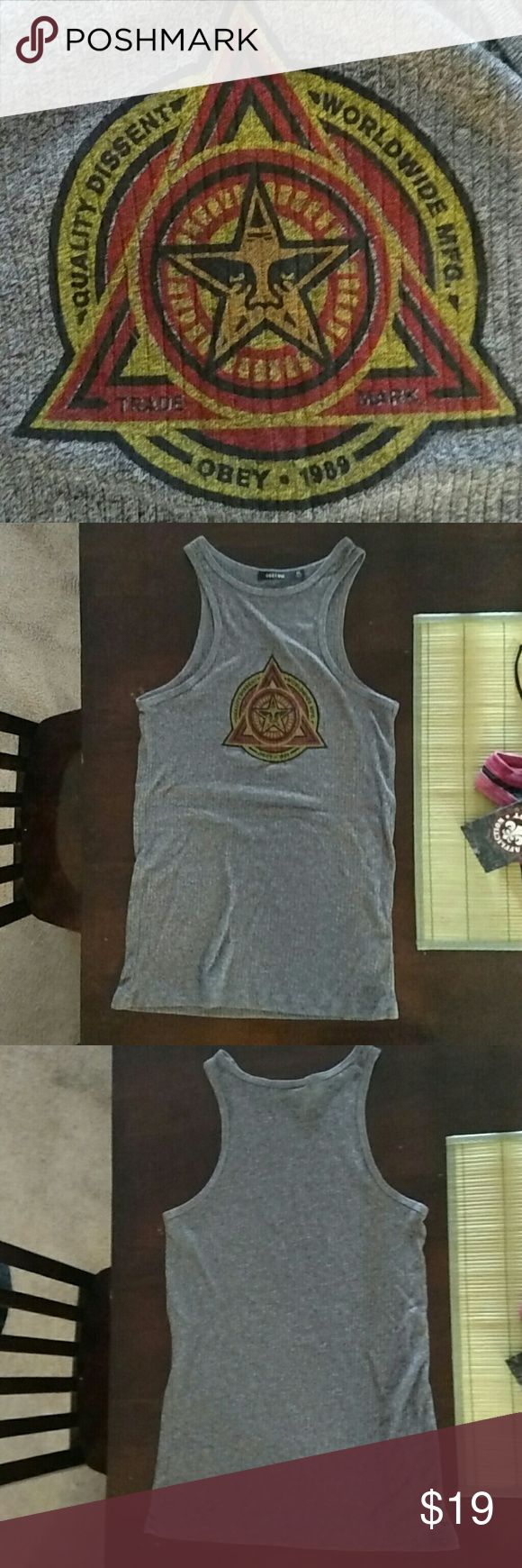 Never worn!!!! Obey No89 Tank Top Never worn, only tried on, Obey No89 brand grey high-neck tank top, purchased at buckle 6 months ago. Really cute but unfortunately not really my style anymore. Sorry, no trades!!! I am open to offers however! Very fast shipper, all 5 star feedback :) Obey Tops Tank Tops