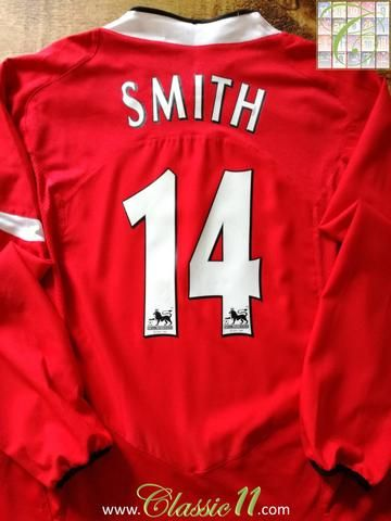 Official Nike Manchester United home long sleeve football shirt from the 2004/2005 season. Complete with Smith #14 on the back of the shirt in Premier League lettering.