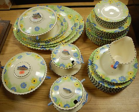 Lot 111 - An Art Deco Burleigh ware part dinner service with yellow and blue floral decoration to include graduated meat plates, tureens and covers etc. Sold GBP80, Jun 2016 auction Lacy Scott & Knight