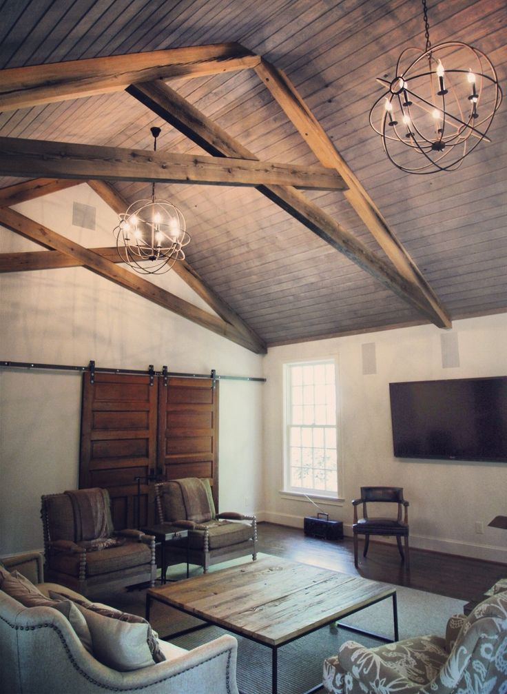 Den Addition with scissor trusses from reclaimed sunken pine and tongue and groove ceiling.- Lovette Construction www.lovetteconstruction.com