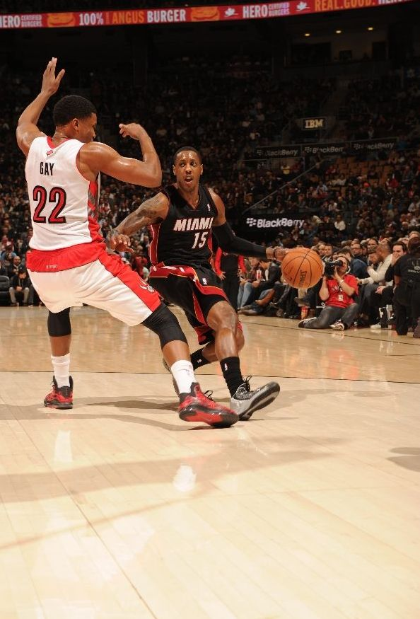 TORONTO, CANADA - November 5: Mario Chalmers #15 of the Miami Heat drives against Rudy Gay #22 of the Toronto Raptors on November 5, 2013 at the Air Canada Centre in Toronto, Ontario, Canada.