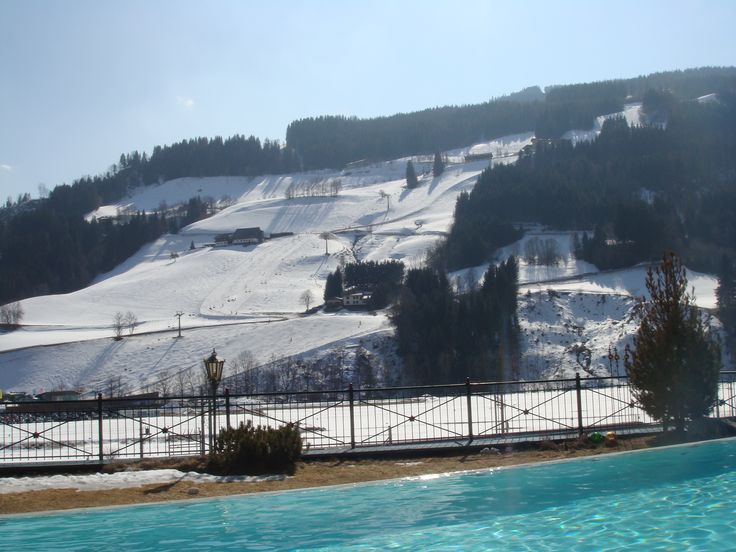 View from the outdoor pool at Hotel Pichlmayrgut close to Schladming