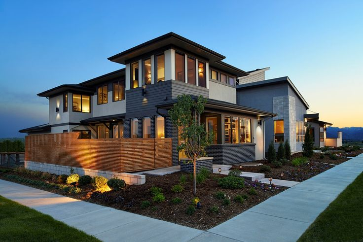 Different exterior materials and textures harmonize beautifully to create this contemporary new home built by Brookfield Residential. The Midtown at Clear Creek community. Denver, CO.