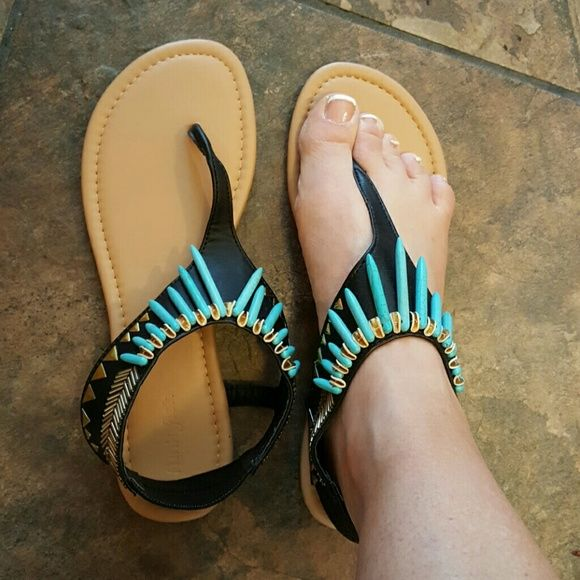 Sandals My mother bought these back for me when she was in Europe. unfortunately my high arches won't allow me to wear these super cute shoes. the brand is funky fish and they are European size 38. They are black, gold, and turquoise. funky fish  Shoes Sandals