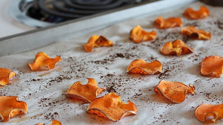 Sweet-potato chips can be even more satisfying than the usual versions, since you get a caramel-like flavor along with salt and crunch. This recipe from the healthy food site BerryRipe.com combines cinnamon and chili powder, so each bite is sweet and a little spicy, too.