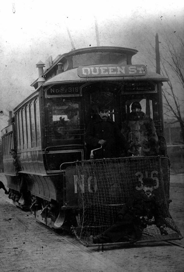 Toronto Railway Company (a predecessor to the TTC) 1893. Electric Streetcars began in 1890's & moved so fast & quiet compared to horse-drawn vehicles, accident rate shot up as people didn't know to look both ways. Life saving fenders at the front of electric cars with an iron bar to knock a pedestrian off his feet and into the net. A gentleman reclines in the net in the pic.