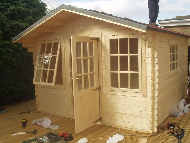 stunning oak wood shed ideas plans with single half glass 9 lite main door and double windowed frontside with wooden floor inspiring prefab home design