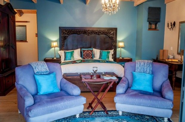 The bedroom at The Tintswalo Atlantic Hout Bay.  The large sitting chairs look out on the Atlantic Ocean and we could sit forever watching t...