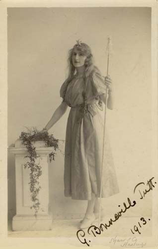 "A young woman dressed in the apparel of a good fairy, photographed at the Hastings studio of Shaw & Co. (1913). Sidney Shaw & Co. was based at 51c Robertson Street, Hastings from 1903 until 1918. This picture postcard is signed ""G. Bonneville Tutt, 1913"". Gladys Bonneville Tutt was born in Hastings in 1887, the daughter of Eliza and John William Tutt, a Hastings coal merchant. In 1916, Gladys Bonneville Tutt married Charles L. Flux."