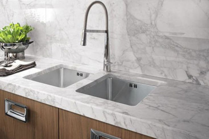 Silestone Lyra for a bar and a backsplash or the whole kitchen. If this isn't the best thing since sliced..... marble I don't know what is. I'm a huge fan of this new material and I'm truly a marble fan but this is the best of both worlds in the kitchen