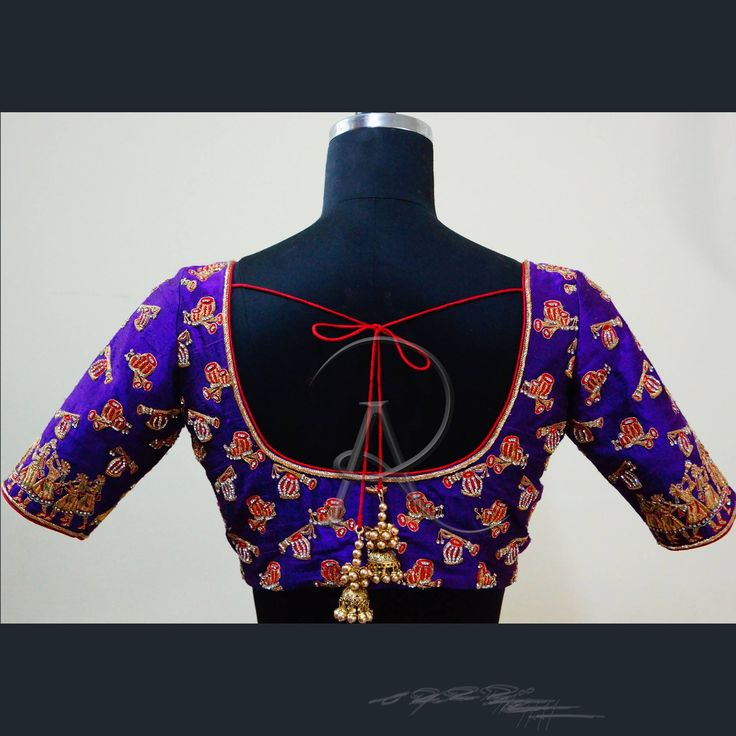 Beautiful designer blouse in peacock blue color with drums design with red tie back. 20 December 2017