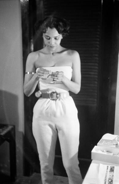 Dorthy Dandridge.  pantsuit/halter but look at that golden arm clasp. arm clasp.