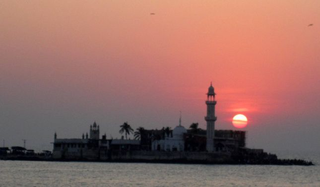 The #Haji_Ali_Dargah is a mosque and dargah located on an islet off the coast of #Worli in #Mumbai. The revered #dargah is located on a bed of rock 500 yards into the Arabian Sea.