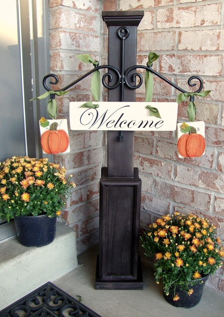 DIY Seasonal Welcome Post  Beautiful, I saw a smaller version of this, with just a coat hook on the post for hanging the different signs.  So pretty!