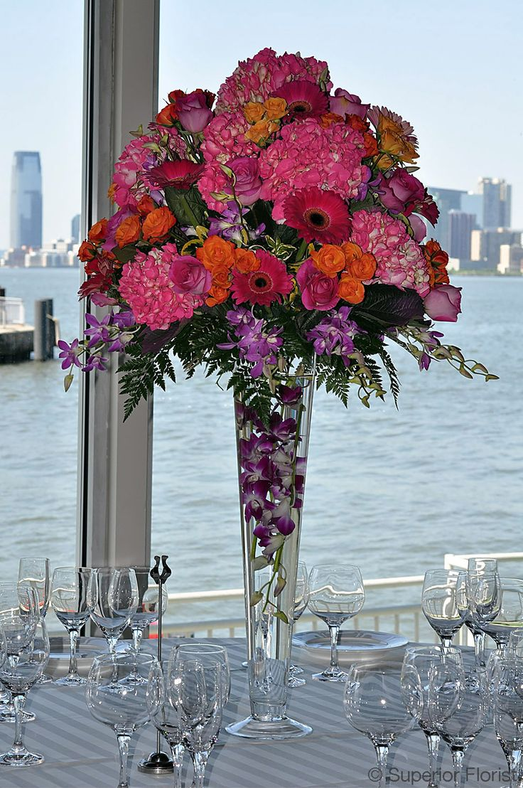 28 best wedding dinner centerpieces images on pinterest wedding superior florist centerpieces pink hydrangeas gerberas and orange spray roses in a trumpet reviewsmspy