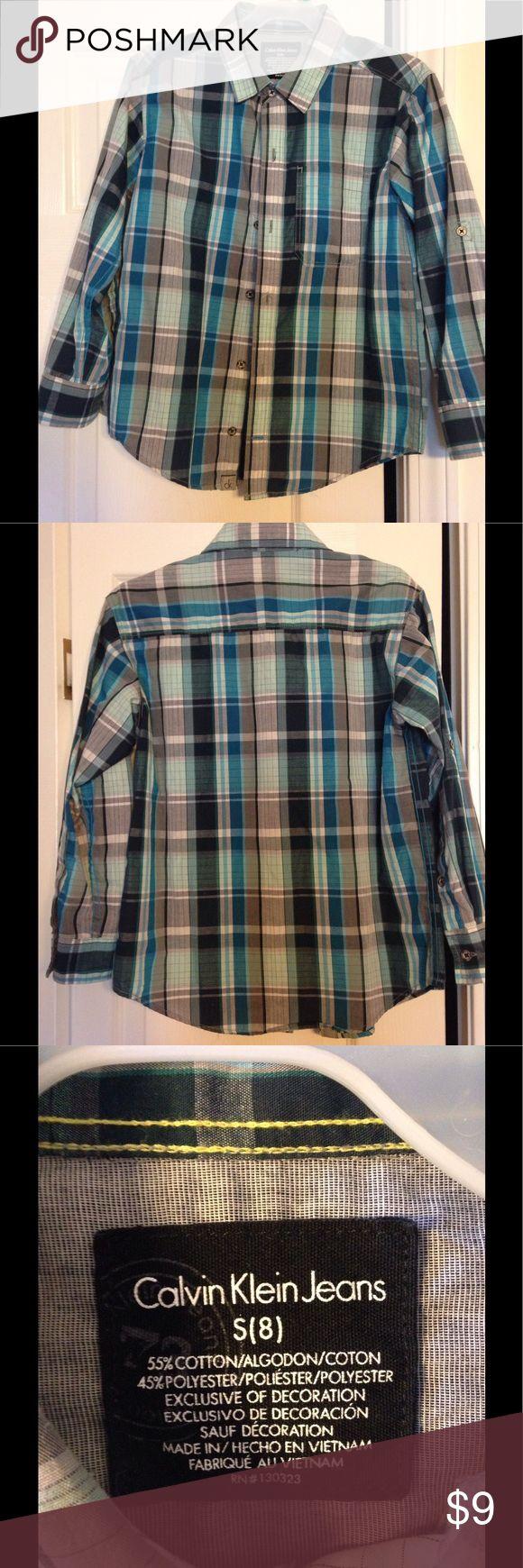 EUC Calvin Klein Jeans Plaid Boys Shirt Size 8 EUC Calvin Klein Jeans Plaid Boys Button Up Shirt. Size 8. 55% Cotton 45% Polyester Calvin Klein Jeans Shirts & Tops Button Down Shirts