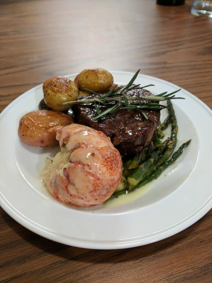 [Homemade] Surf And Turf. Butter Poached lobster Tail USDA Prime Filet Mignon Rosemary Baby Potatoes Lemon Garlic Asparagus