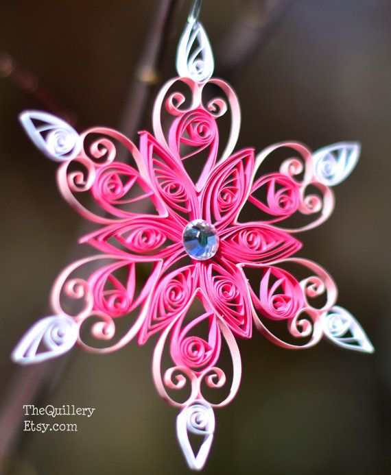 What else is more beautiful than a handmade ornament using the art of quilling? This is a handmade quilled Christmas Ornament in a snowflake design.