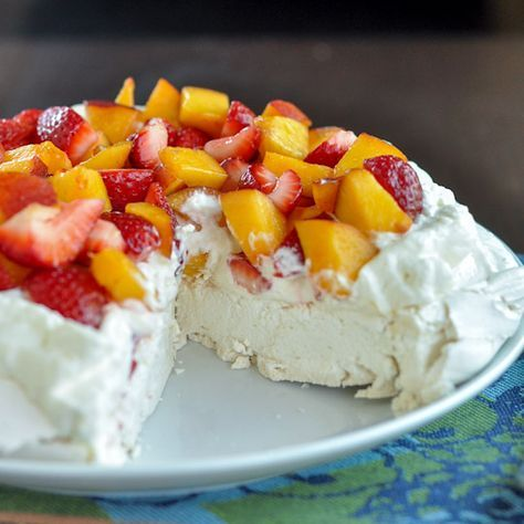 Pavlova is on my list to make this summer -- A giant meringue disk topped with sweetened whipped cream and fresh fruit...from thekitchn.com