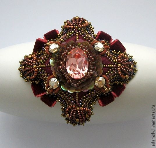17 - Krisitina Adams is beadwork artist from Latvia. She makes amazing unusual bead embroidered brooches.