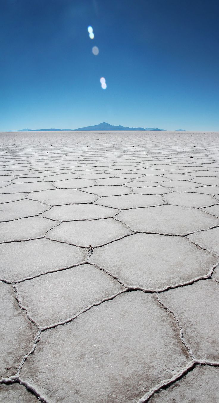 Salar de Uyuni, Bolivia. Find out about exploring the largest salt flats in the world on A Globe Well Travelled.