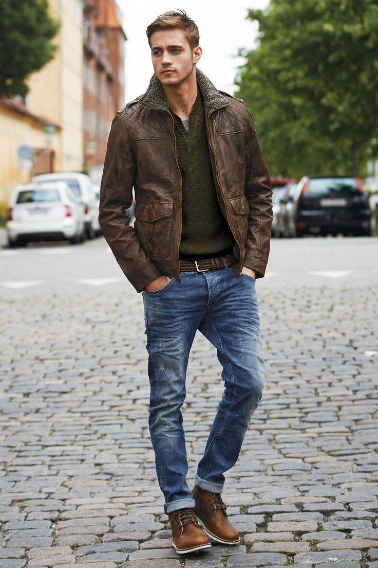 dark brown leather barn jacket, army wool sweater, brown boots. tan or camel jeans would be better. less groomed hair. raise waistline a little