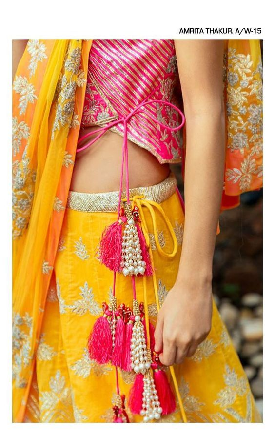 yellow and pink lehenga - forever stunner! And don't miss the combination of peals and tassels on the side! So pretty! #IndianWedding #Mehendi #lehenga #inspiration | Curated by #WittyVows - Things no one tells Brides | www.wittyvows.com