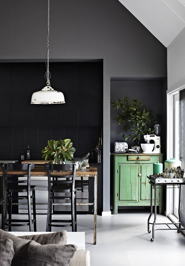 open kitchen space and a perfect green cabinet set off against a grey palette