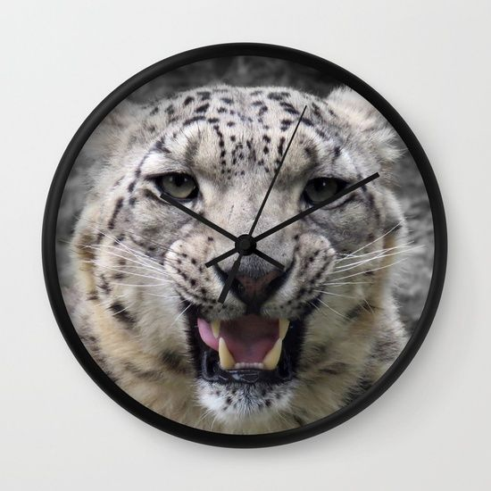 Angry snow leopard Wall Clock