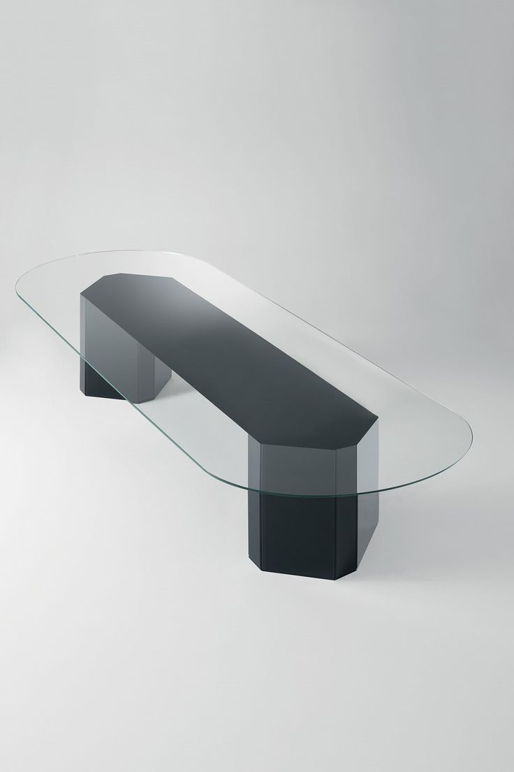 Harkavy furniture focuses on modern pieces made of wood and steel - This Stunning Contemporary Dining Table Has A Glass Top Available In A Range Of Finishes And A Wooden Base Covered By Painted Glass Creating The Perfect
