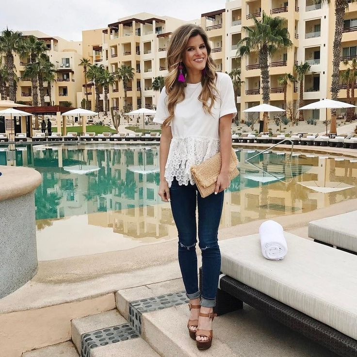 lace eyelet trim white tee, distressed jeans, purple fun statement earrings, cabo outfit