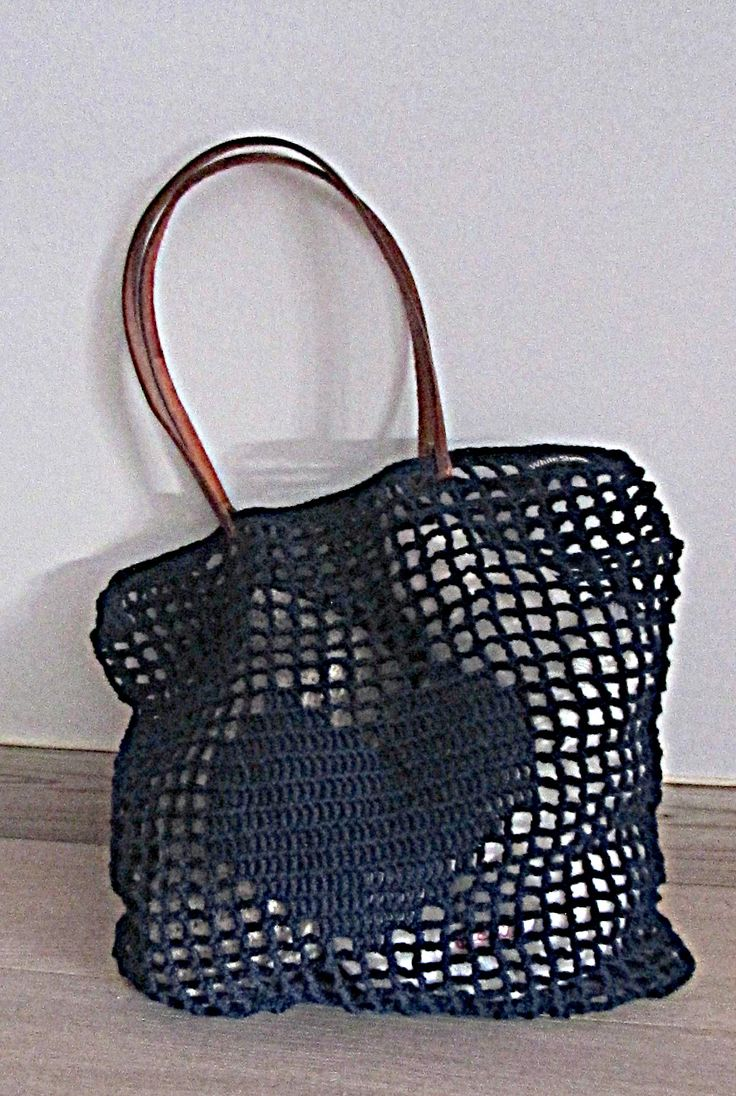 """Versatile, amazing and stylish crochet market tote bag. The crochet bag is made with the """"filet crochet"""" technique. I have used a thin needle and strong cotton yarn. The bag looks delicate but at the same time they are sturdy. The design allows it to stretch to accommodate bulky or awkward shapes. The handles are made of leather. https://www.etsy.com/shop/WhiteSheepShop"""