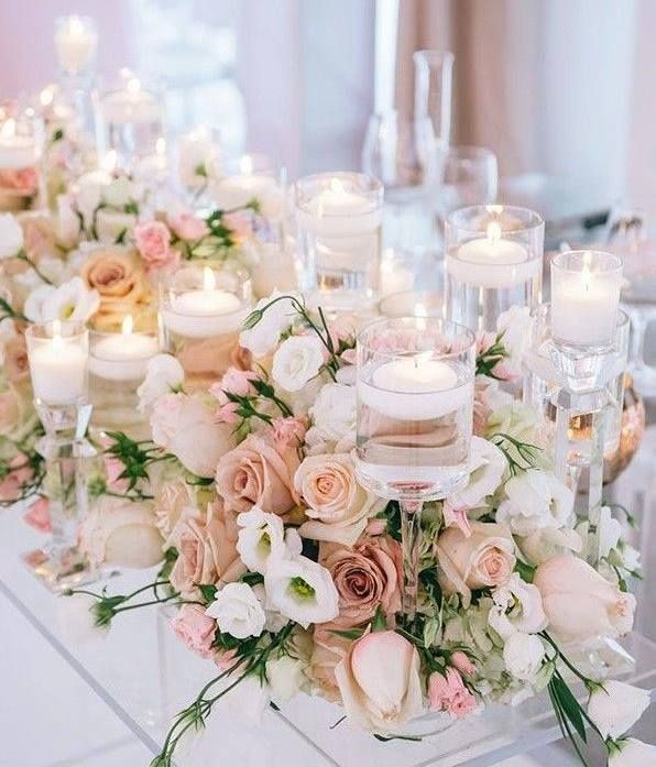 Gorgeous blush pink roses and tea lights, what a perfect combination!